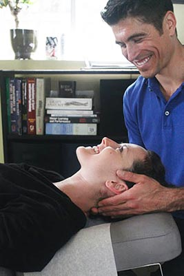 Chiropractor San Francisco CA Dr. John Lutz Adjusting Patient Neck