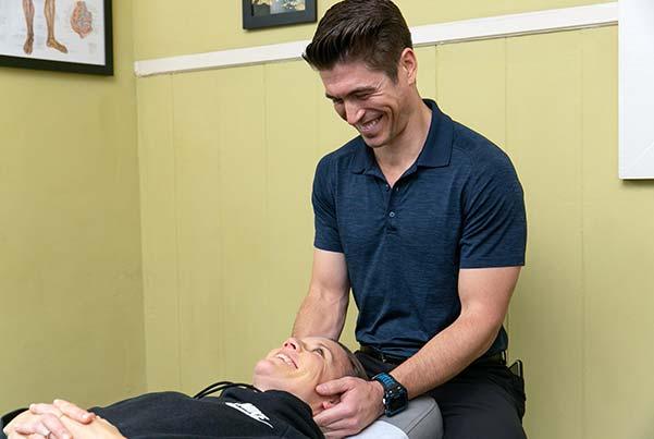 Chiropractor San Francisco CA Dr. John Lutz Adjusting Patient