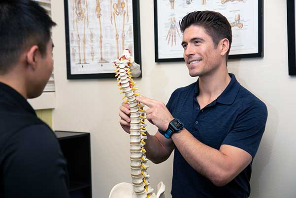 Chiropractor San Francisco CA Dr. Nick Cruze Talking with Patient